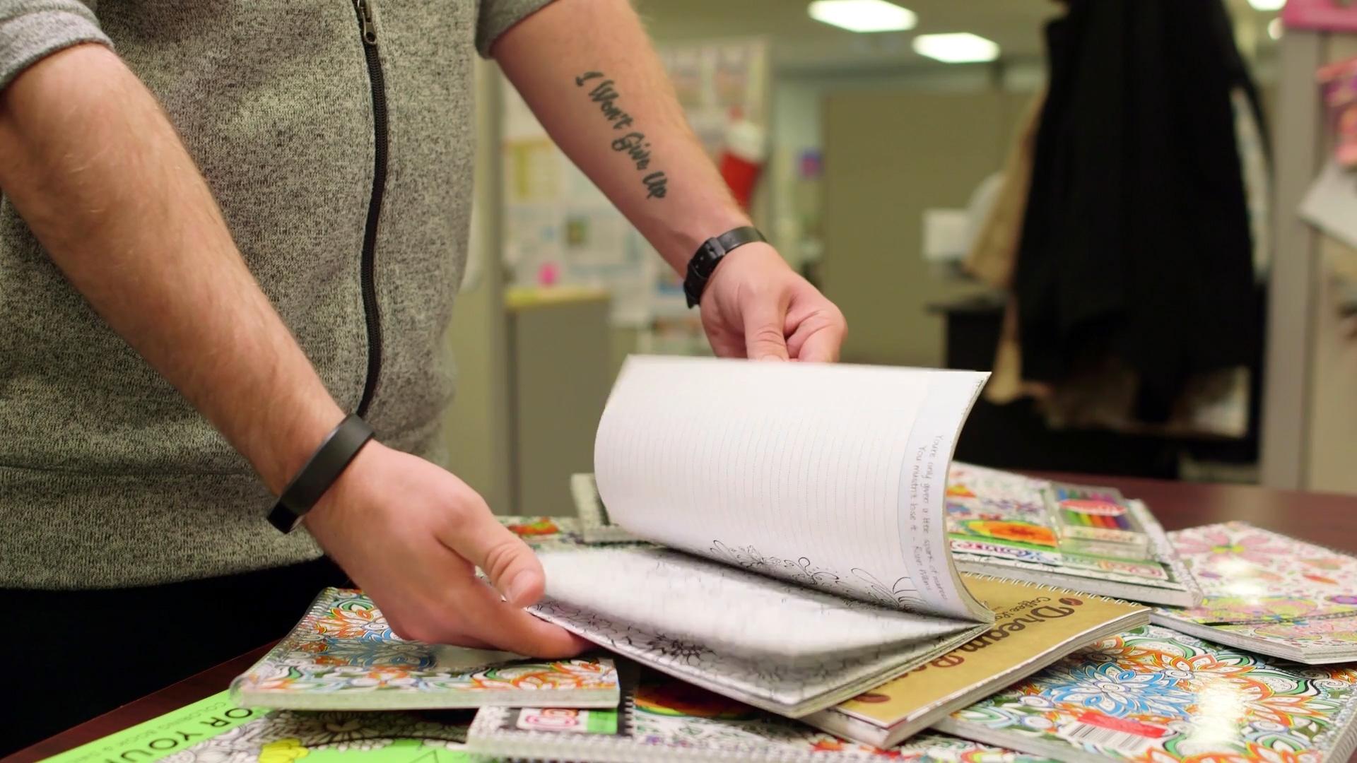 SDI Innovations employee flipping through notebook.