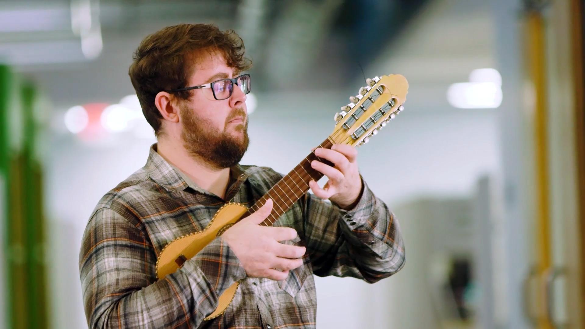 SDI Innovations employee playing ukulele.
