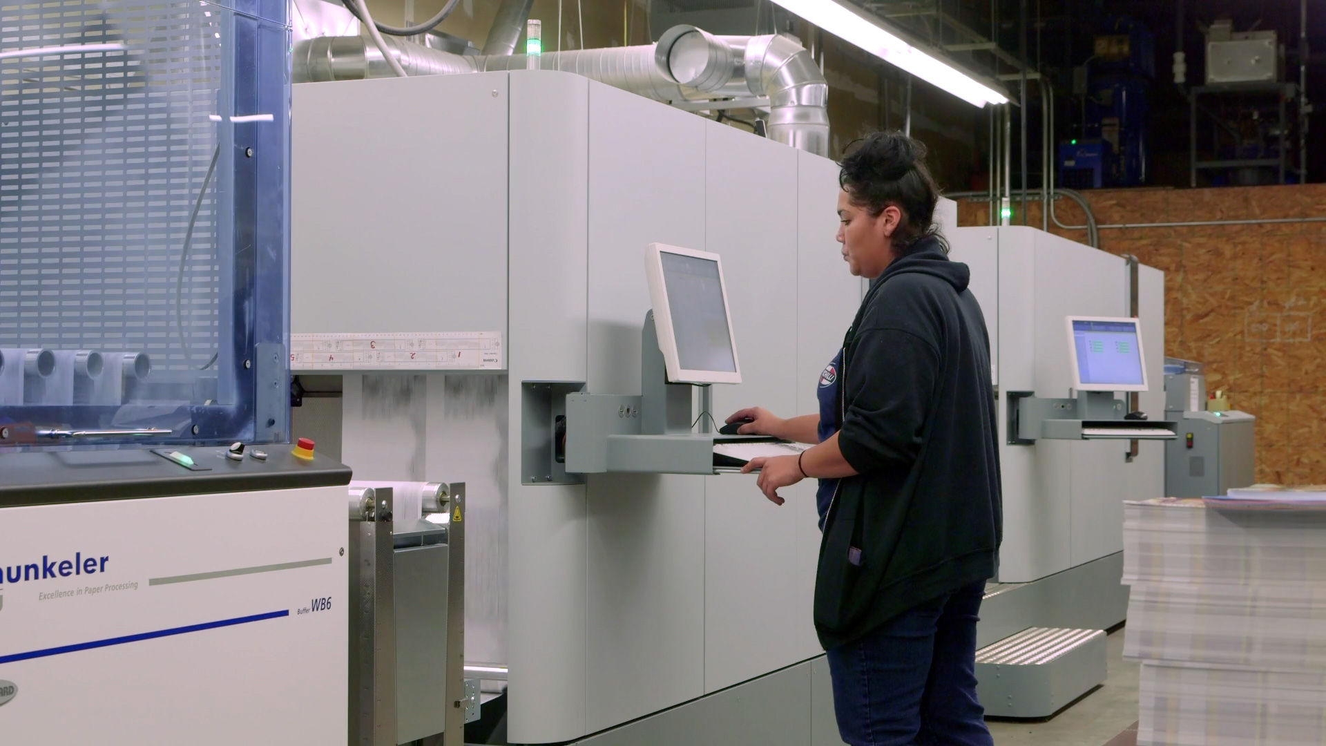 SDI Innovations employee working at printer.